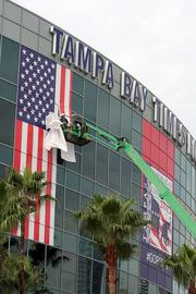 Old Glory takes shape on the side of the Tampa Bay Times Forum before the RNC next week.