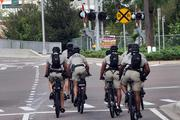 Bike police approach the intersection of Meridian Avenue and Kennedy Boulevard.
