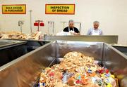 Workers sort the bread by hand, discarding what's unusable.