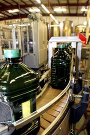 Large bottles of olive oil, often seen in club stores, comes off the line.