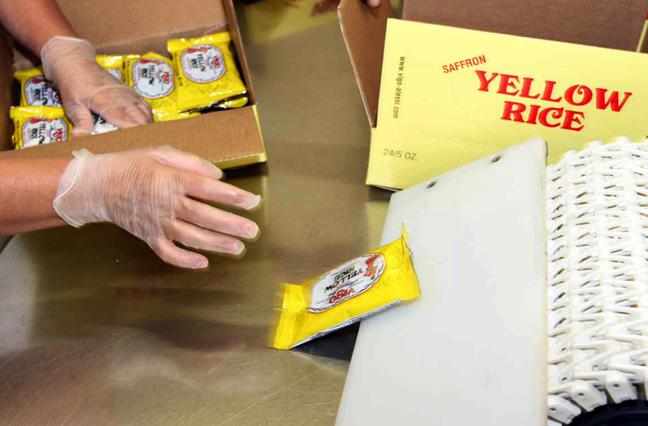 Packages of yellow rice come off the line. This is the company's top selling product.