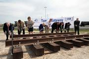 Officials prepare to drive ceremonial railroad spikes at the Tampa Port Authority's opening event for the new rail loop.