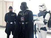 Darth Vader and Stormtrooper costumed fans at Tampa Bay Comic Con