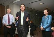 Jim Davis, former U.S. Representative and part of the campaign leadership, Stuart Rogel, president of Tampa Bay Partnership, and Mayor Pam Iorio