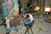 Jeff Monsein, owner of Splat Paint in Tampa, painting the column part of the mural.