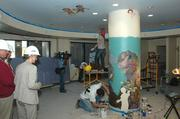 Workers are completing a mural that will be featured in the new NICU at Tampa General Hospital. Kristen Alatorre-Martin, an artist with Splat Painting, paints the ceiling.