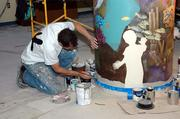 Jeff Monsein, owner of Splat Paint in Tampa, paints the column part of the mural.