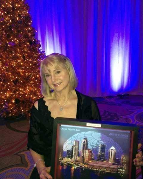 Karen McKinney with her CREW Tampa Bay Award.  Courtesy of Elements