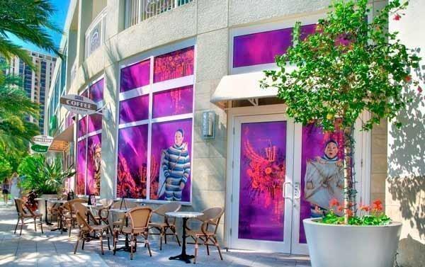 "Cassis American Brasserie's windows reflect scenes from Cirque du Soleil show ""Kooza."""