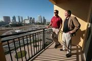 Hardin Construction Co.'s Nick Nieto, superintendent, and Page McKee, senior VP and GM Tampa office, on the balcony of a two-bedroom overlooking Tampa.