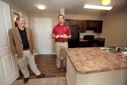 Hardin Construction Co.'s Page McKee, senior VP and GM Tampa office, Nick Nieto, superintendent and Andrew Black, project manager in a two-bedroom unit.