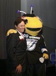 CBIZ partner Bruce Murphy and Tampa Bay Lightning mascot ThunderBug.