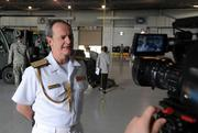 Spanish Navy Rear Adm. Javier Romero, Defense Attaché, gives an interview at MacDill Air Force Base. Romero is escorting half of one billion dollars of Spanish coins, which were lost at sea in the 19th century and unearthed three years ago, back to Spain.