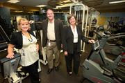 A scene from the gym at Catalina Marketing. Pictured are Debbie Booth, executive vice president business support services, Keith Morrison, executive director of Total Rewards and Stacie Linne, human resources, director, benefits & wellness.