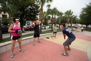 A scene from a Fowler White boot camp in downtown Tampa park. Andrea Zelman, Charles Piercy (U.S. Navy retired)  and Bea LeVine, gets instruction from Cody Fairbanks, coach for Hit It Hard Boot Camp.