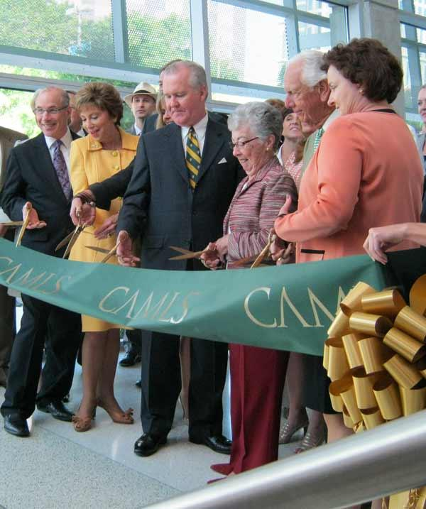From left cutting the ribbon are Dr. Stephen Klasko, CEO of USF Health, USF President Judy Genshaft, Tampa Mayor Bob Buckhorn, Carol Morsani and Frank Morsani, and Dr. Deborah Sutherland, CEO of CAMLS.