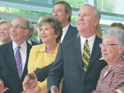 At the ribbon cutting are, from far left, Fowler White Boggs' CEO Rhea Law, Dr. Stephen Klasko, USF President Judy Genshaft, Colliers Arnold CEO and Founder Lee Arnold, Tampa Mayor Bob Buckhorn and Carol Morsani.