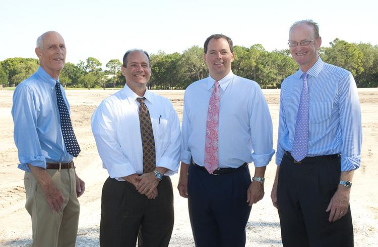 Mark Sochar, Michael Rego and John Neal with John Neal Homes and Charles Varah, partner representative at University Park