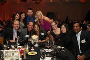Honoree Marlene Velez, center, with her coworkers and tablemates.