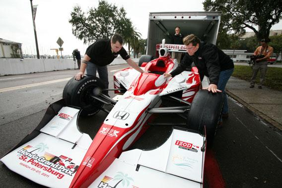 Tim Ramsberger, VP and general manager, right, helps move the official Honda Grand Prix show car, during the 2011 event.
