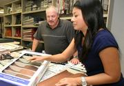 Arthur Rutenberg Homes' Ed Brown, VP of construction and purchasing, consults with vendor My-Kim Tran, design center specialist with Eagle Roofing Products.