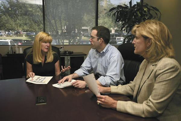 Eileen Auen, chairman and CEO of PMSI, Jay Krueger, chief strategy officer, and Lori Daugherty, pharmacy president, in a strategy meeting.