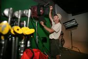 Rhino Studio's co-owner and President Cliff Gephart prepares the studio for a production shoot.