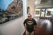 Crislip Arcade's shops include Gallery Woo owned by artist Bill Correira, aka Fish Guy, who is in the process of moving into his new second shop down the street in Green Richman Arcade.