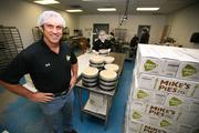 Mike Martin, CEO, in the kitchen with David Aristizabal, who stacks pies for shipment.