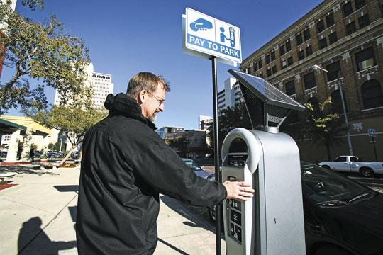 David Twiddy of Tampa uses a new pay station in downtown Tampa.