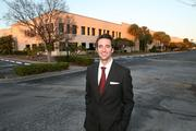 Blake Whitney Thompson outside his newly purchased 200,000-square-foot office building in Largo.