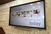 New touch screen technology is available for customers at Grow Financial's new office in downtown Tampa.