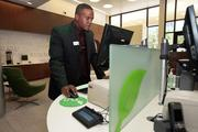 Justin Deskins, branch supervisor, at a cash station at Grow Financial's new office in downtown Tampa.