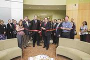 José Rodriguez, vice president of business operations for Matrix Medical Network, center, at the grand opening in mid-May.