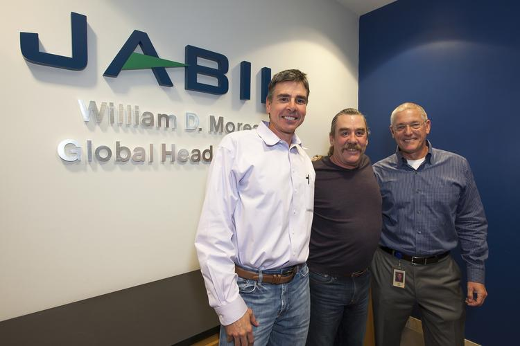 "In January, Jabil renamed its corporate headquarters as the ""William D. Morean Global Headquarters,"" in recognition of 35 years of service by Bill Morean. Morean (center) retired as board chairman on March 1, the same day Tim Main (right), former CEO, became board chairman and Mark Mondello (left) moved from chief operating officer to CEO."