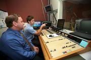 WWBA News 820's Len Weiner, programming manager, and Cody Wilson, audio board operator, in the studio.