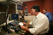 WWBA News 820 radio station's Steve Summers, afternoon news anchor, and Len Weiner, programming manager, in the studio.