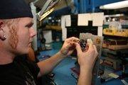 Eric Anderson, calibration technician, calibrating an air speed indicator.