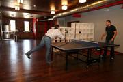908 Development Group. Principal owners,  Justin Wilson and Alex English playing pin pong in their new Ybor office.