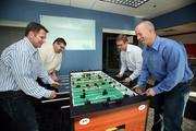 AgileThought's Jeff Alagood, COO, Clare DeBoef, Ryan Dorrell, CTO and David Romine, president and CEO taking a break at work.
