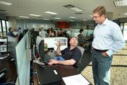AgileThought's Marc Miller, solution architect and Ryan Dorrell, CTO talking in the bull pen.