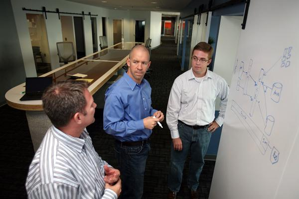 AgileThought executives Jeff Alagood, David Romine and Ryan Dorrell meet in their new offices.