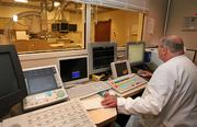 At Mease Countryside Hospital, Jim McIlvaine, cardiac catheterization lab manager, records a patient's procedure.