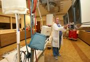 At Mease Countryside Hospital, Jim McIlvaine, cardiac catheterization lab manager, sets up for a patient.