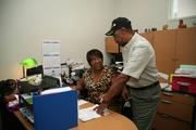 Reggie Tim, president of 3 Vets Inc. and Margarette McDowell, office manager/sales in Tampa.
