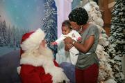 At International Plaza, Dalia Colon and her daughter Norah greet Santa.