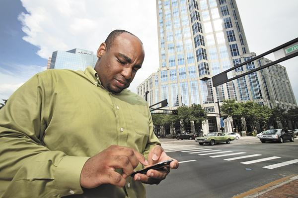 Jeremy Fairley, interactive marketing manager for Tampa Bay & Company, uses the new mobile website to explore downtown Tampa.