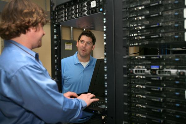 Steve Eschweiler, Hivelocity general manager, works with Ben Linton, chief technology officer, on a web server.