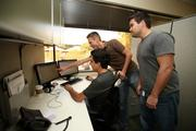 Frank Behzad, business analyst, Phil Skiba, QA analyst, and Andy Knieriem, software engineer discussing a project.