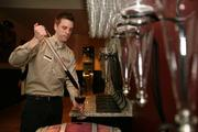 Al Markovich, bar trainer at Cooper's Hawk Winery, gets wine from the wine makers barrel reserve.